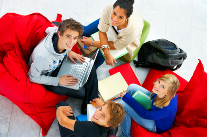 Studygroup relaxing in beanbags while doing school work.